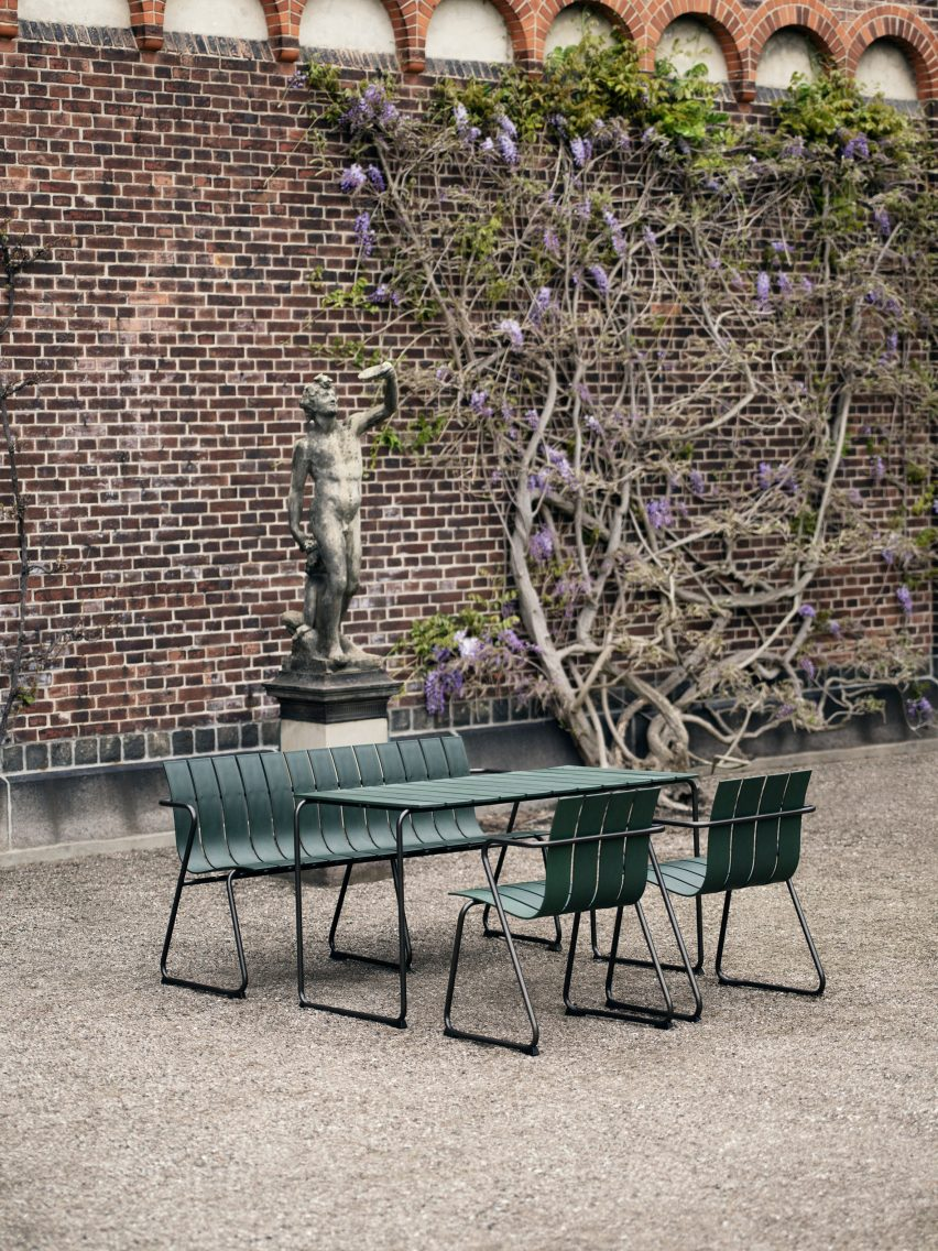 Ocean OC2 outdoor seating in dark green with benches, chairs and tables