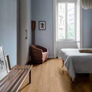 Warm bedroom with oak-style floor