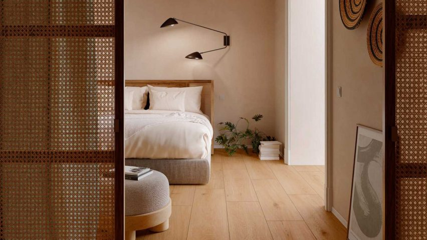 Blush-pink bedroom with tiled timber-like floor