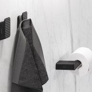 Black towel hook with 3D pattern by Geesa