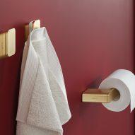 Brushed gold towel hook with toiler roll holder