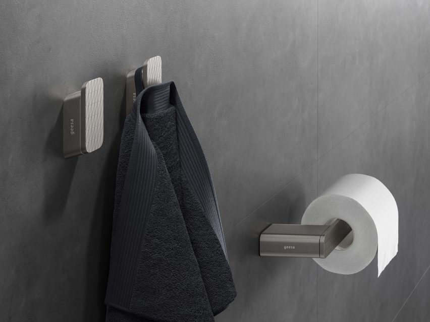 Brushed stainless steel bathroom accessories mounted on wall
