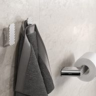 Towel and toilet roll hanging in bathroom
