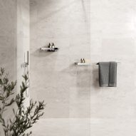 Marble tile shower with chrome bathroom accessories