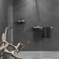 Brushed stainless steel towel rail in dark bathroom
