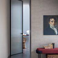 Open pivoting glass door by Lualdi