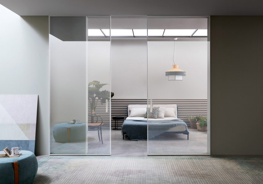 Extraclear glass sliding doors across a bedroom
