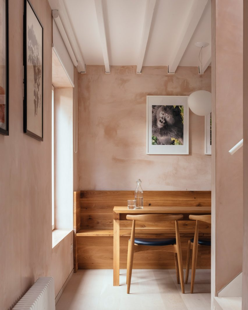 Oak dining table with light passing through a large window