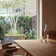 Oak dining table by a large window