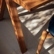Shadows cast on the corner of an oak dining table