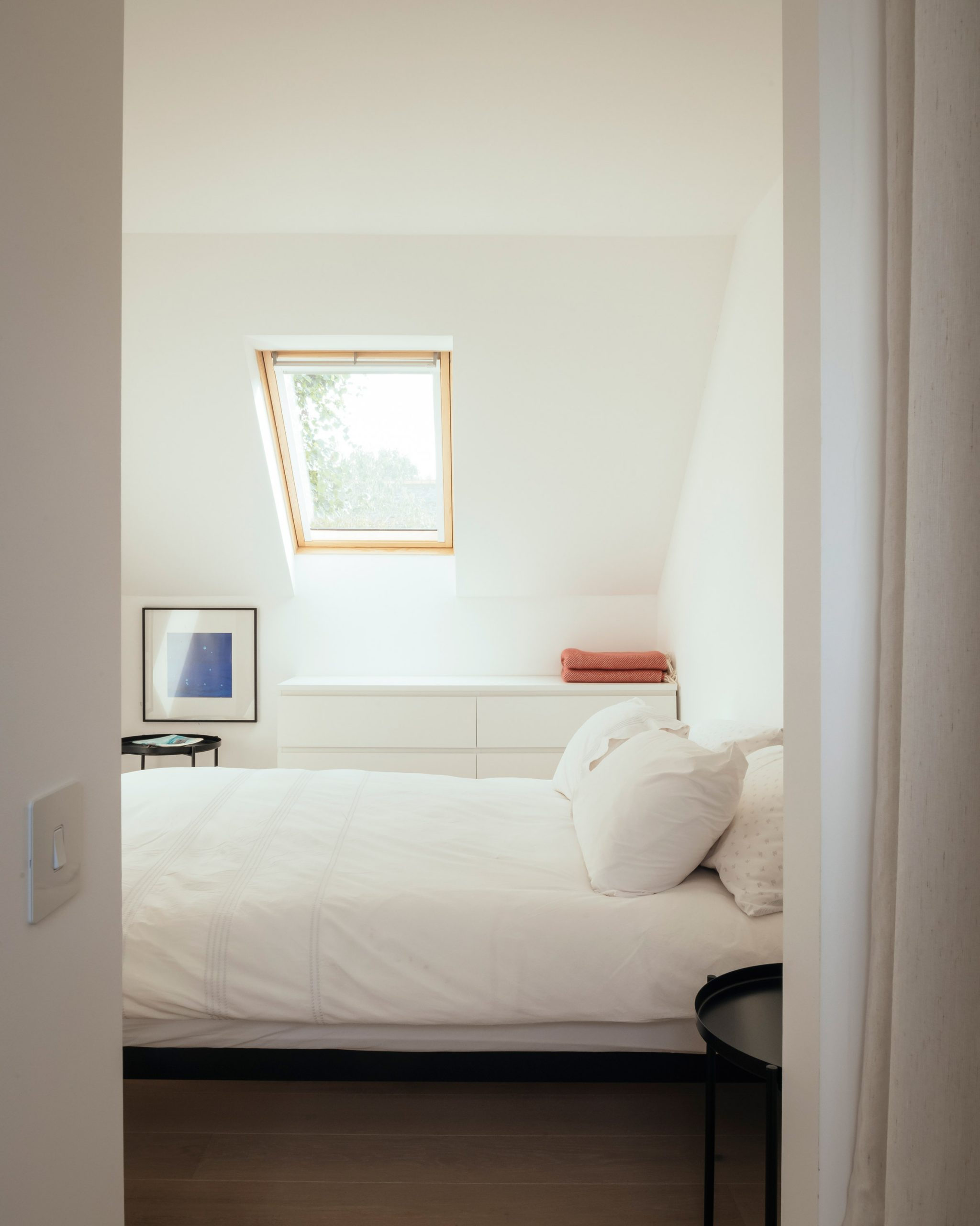 White bedroom with roof light