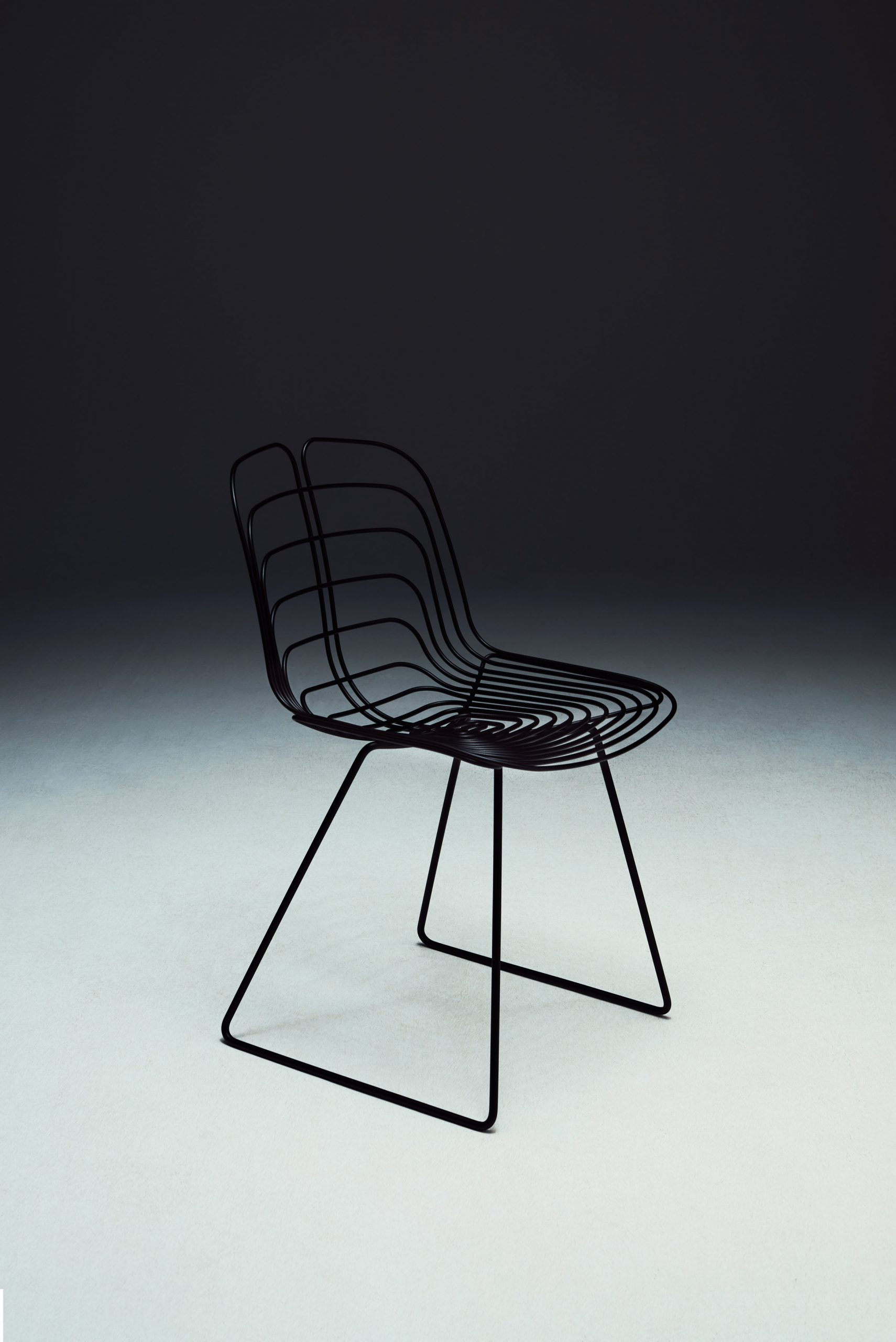 Black chair with sled legs by Michael Young for La Manufacture