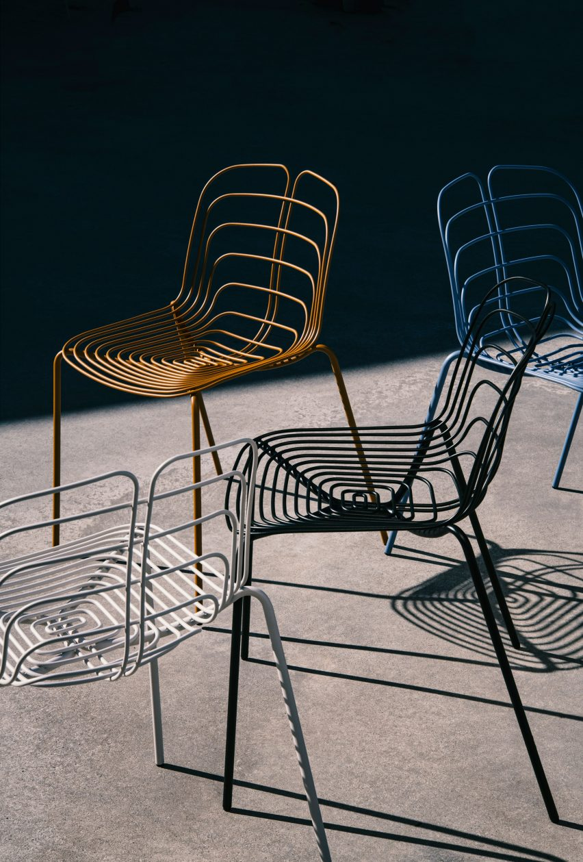 Four Wired chairs in white, black, blue and bronze