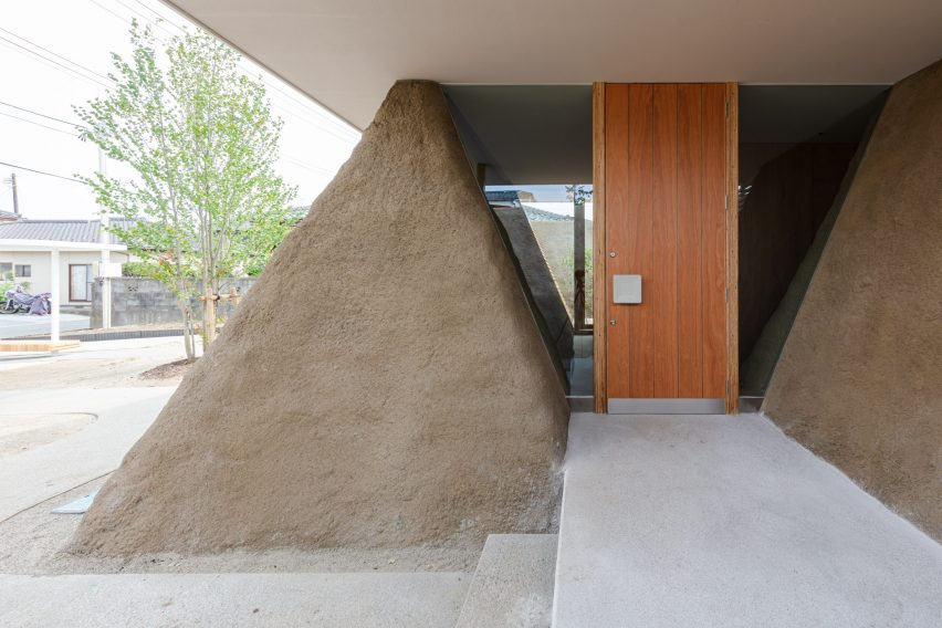 Trapezoid soil walls of house in Minamisoma