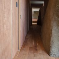 Corridor mixing timber with soil walls