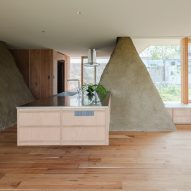 Mounds of surplus soil form walls in Japanese house by ADX