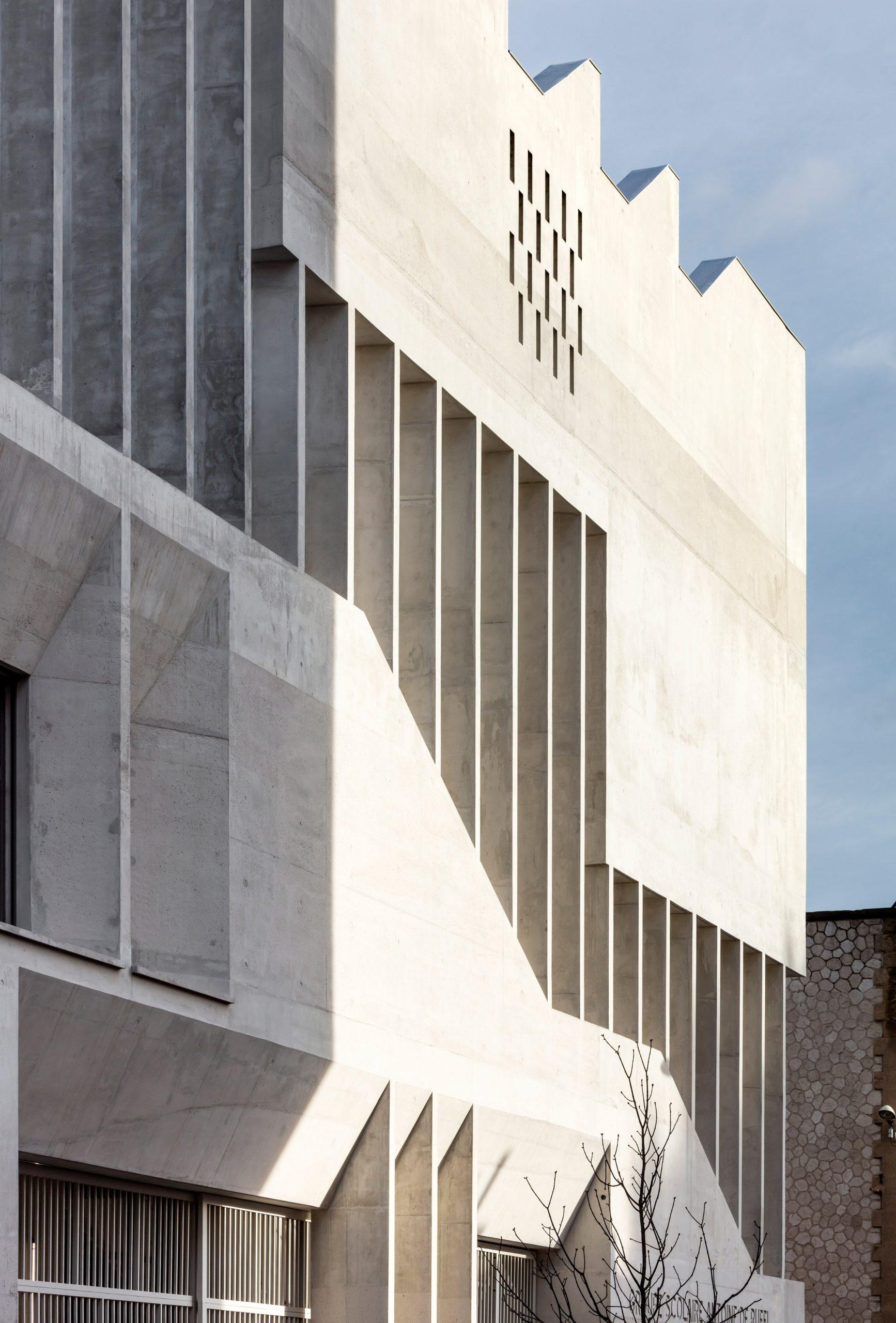 Light hits the building forming geometric shadows