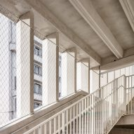 A staircase winds between openings