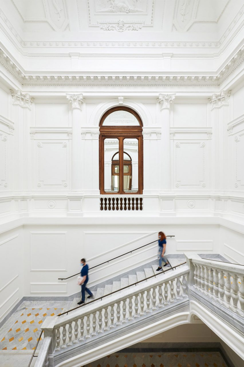 Decorative mouldings cover the walls and ceilings of Apple Via del Corso