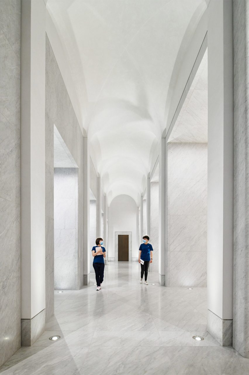 The corridor has a curved ceiling