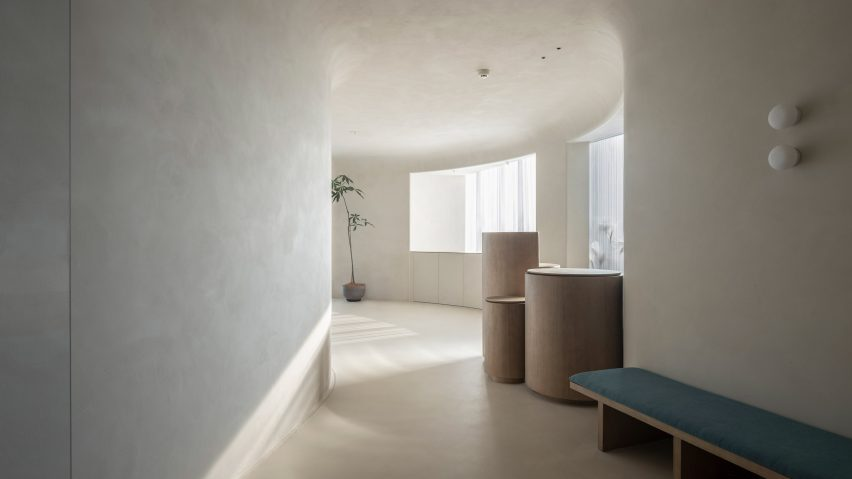 Windows are lined along the curved walls of Soul Realm SPA House by Atelier Right Hub
