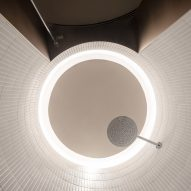 Circular halo lighting was placed above the shower