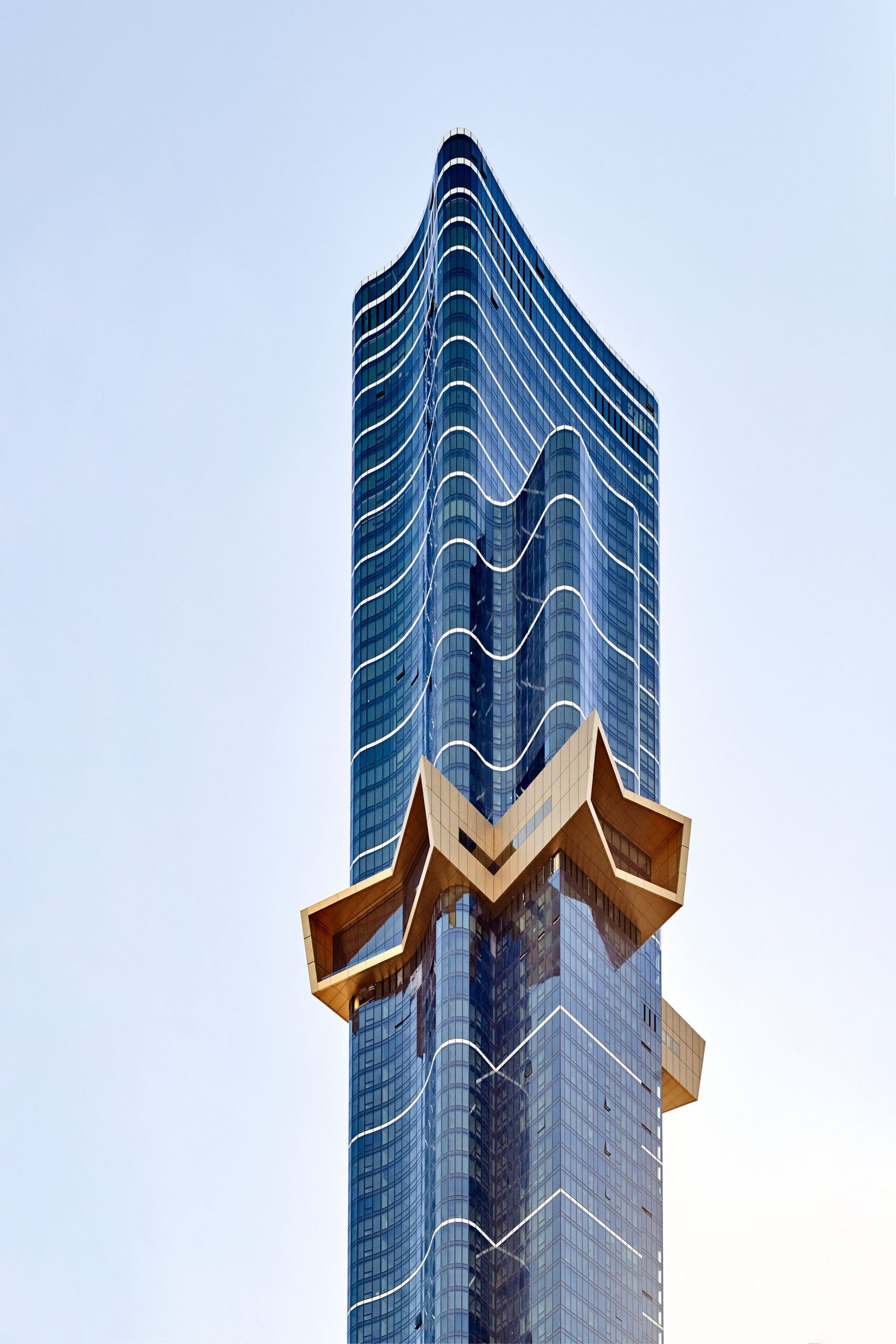 A golden star protruding from a skyscraper