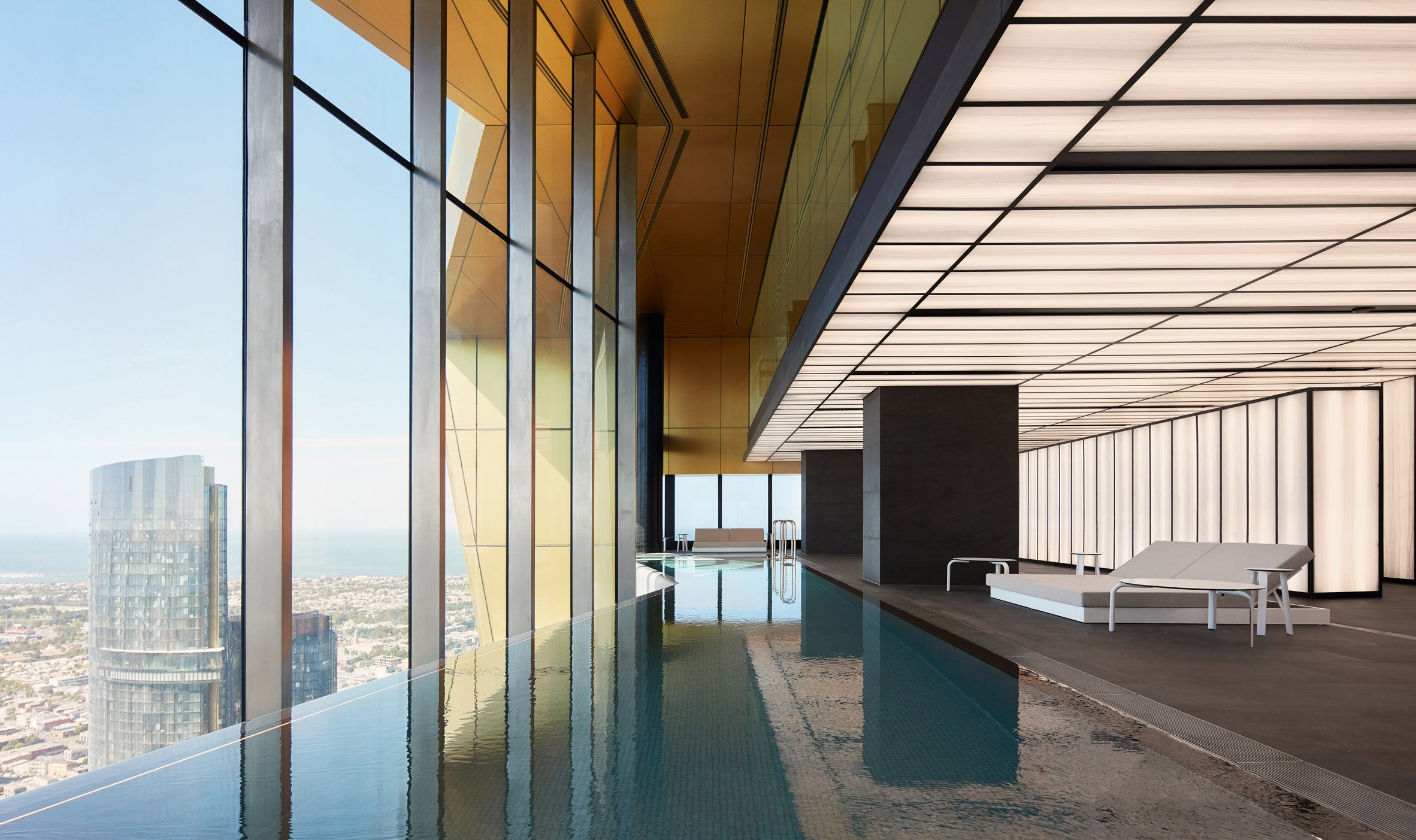 An infinity pool overlooks Melbourne by