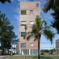 Pink brick clads Baigorria housing project in Argentina by BBOA