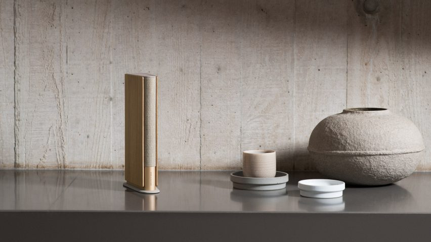 The Beosound Speaker has a gold and oak finish