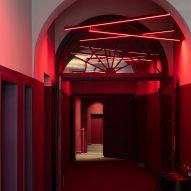 Red cinema hallway with neon lights