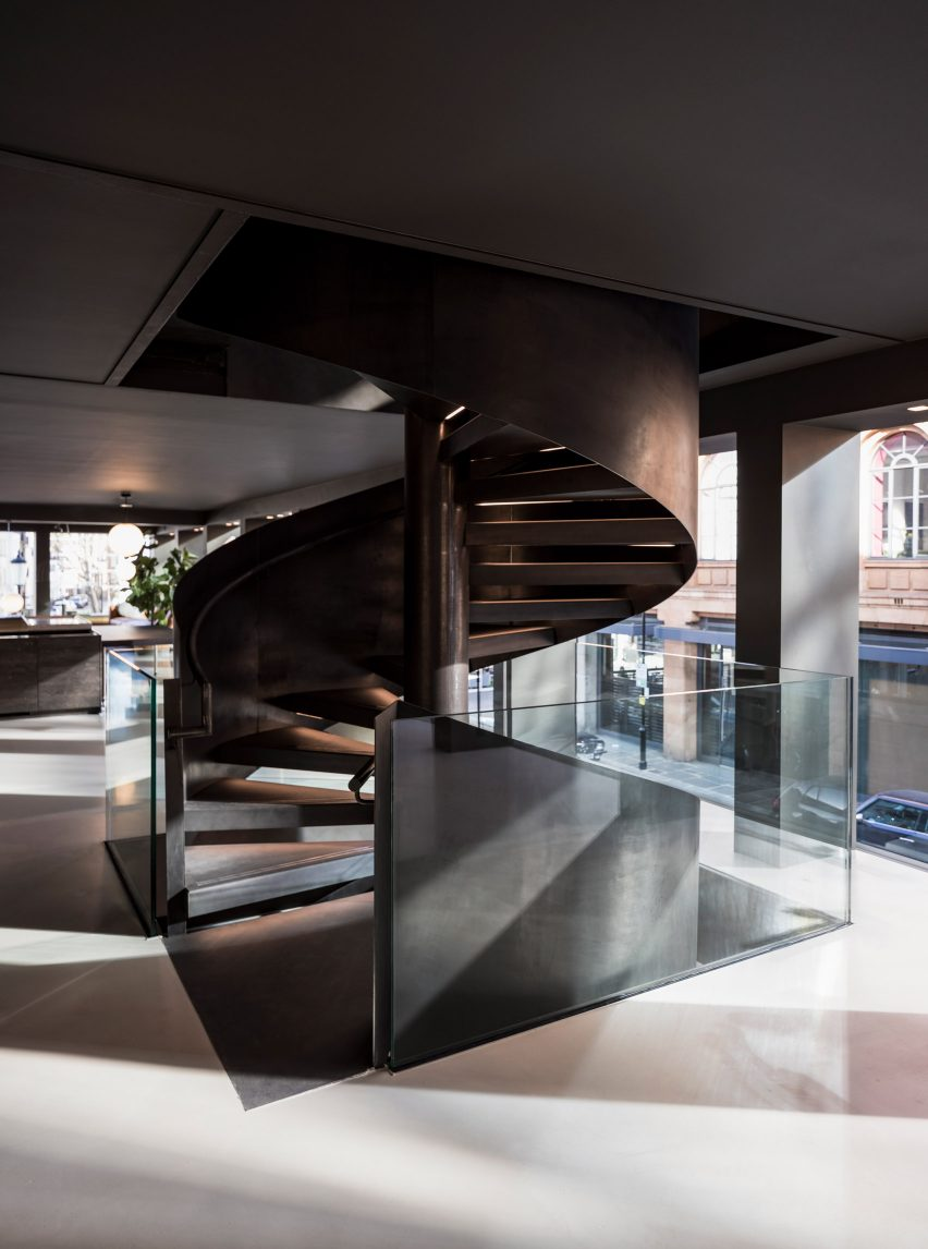 Helical spiral staircase clad in metal in a London furniture showroom