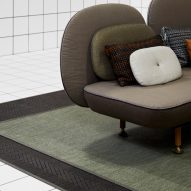 A sofa on a dusky green rug by Bolon
