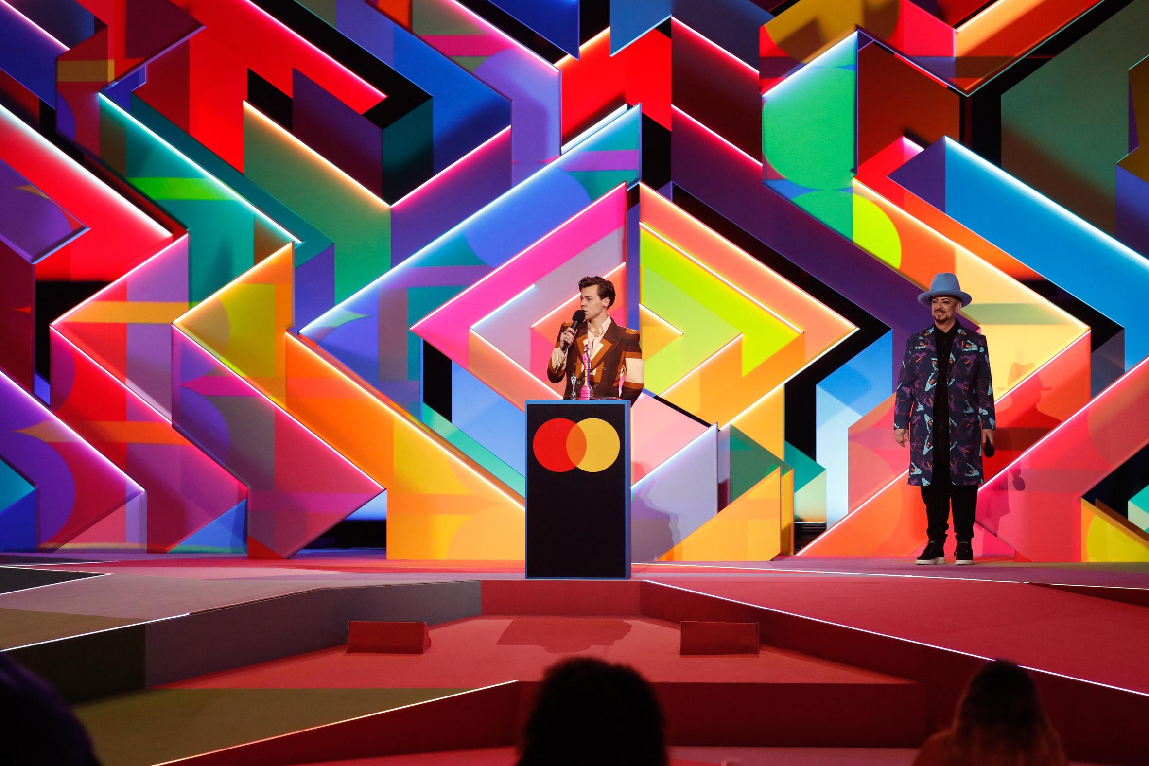 Harry Styles in front of Es Devlin's set design for Brit Awards 2021