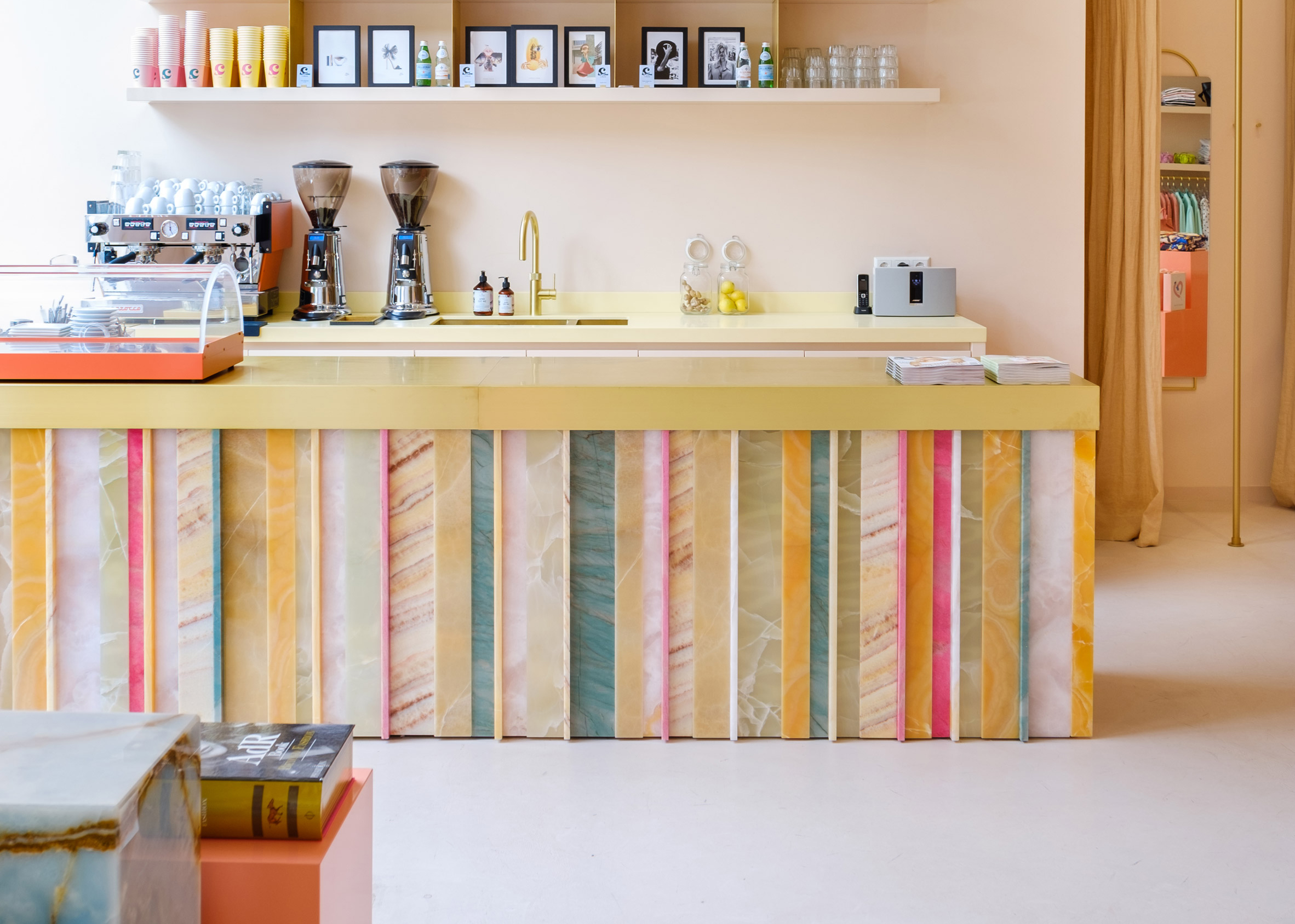A bar lined with colourful onyx stone