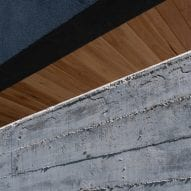 Concrete wall with timber ceiling