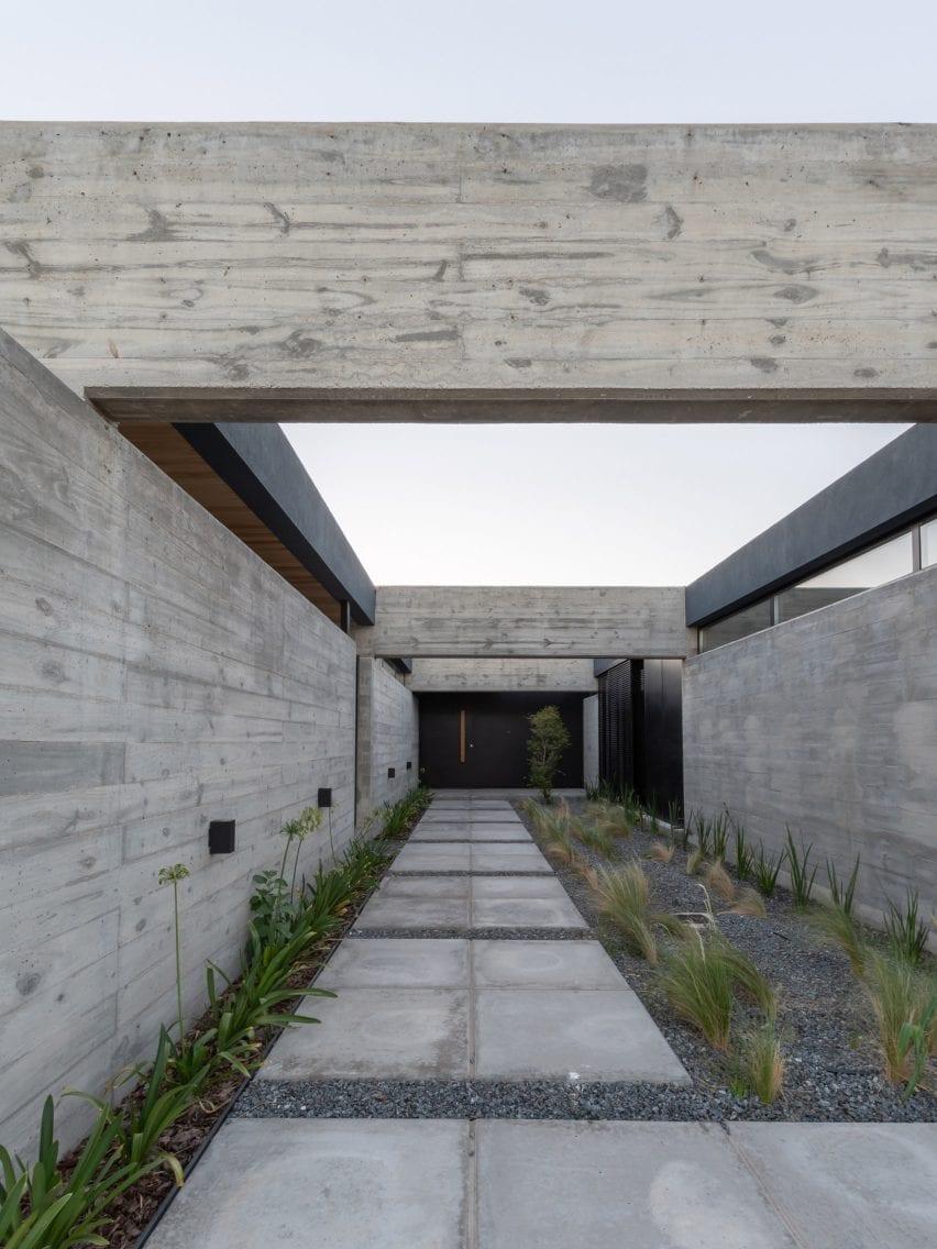 Intersecting concrete slabs lead to front door