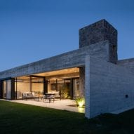Concrete and stone house at dusk