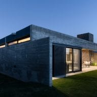 Imposing concrete house at night