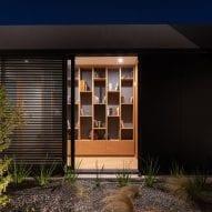 Built-in bookcase overlooking courtyard