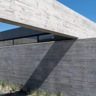Intersecting concrete slabs forming house