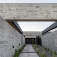 Overlapping stone and concrete layers form Casa SAB by PSV Arquitectura