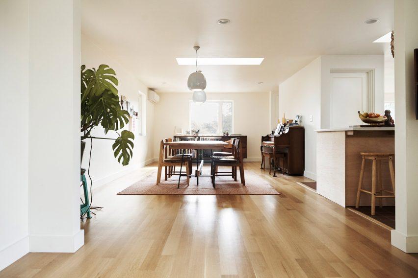 Neutral interiors contrast with darker cedar cladding