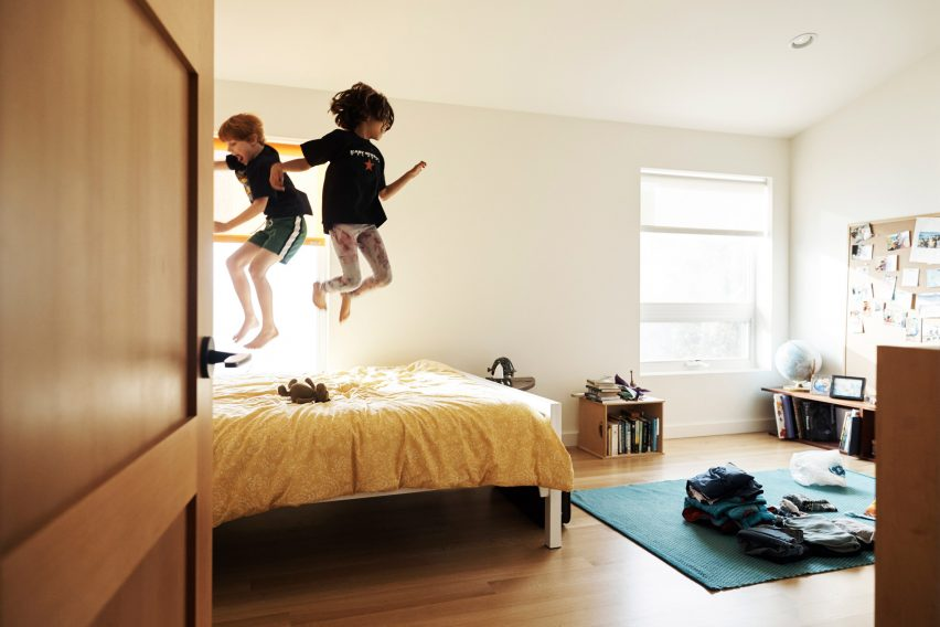 The couple's children enjoy jumping on their bed in Central Area Home