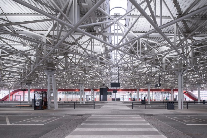 The bus terminal waiting area has a red finish by Chybik + Kristof