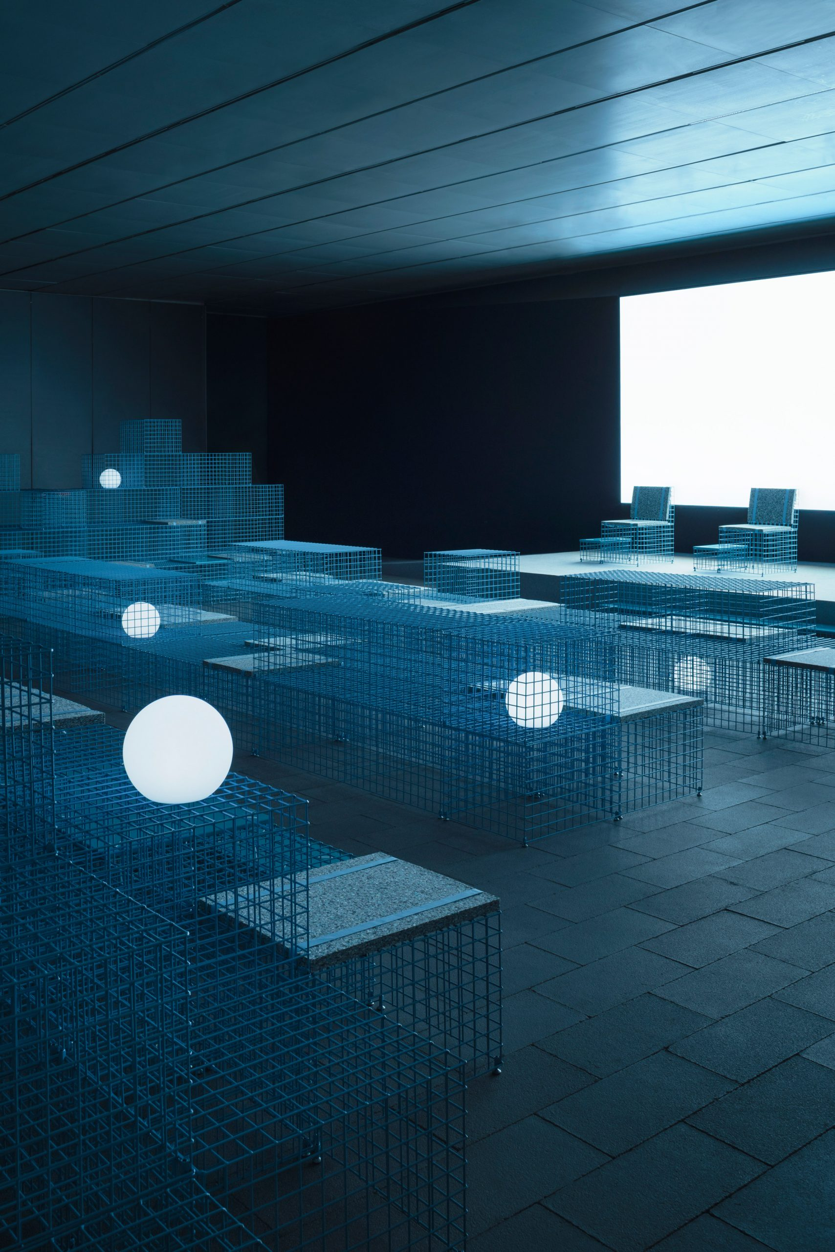 The installation used gridded metal boxes to create seating