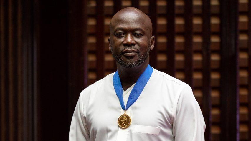 David Ajdaye wearing the Royal Gold Medal