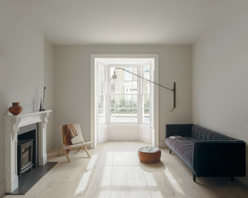 Light wood covers the floors of the lounge in Concrete Plinth House