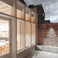 The extension has a light concrete exterior