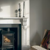A log burner was fitted within a fireplace